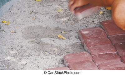 Worker Laying Stone Paving Slab. Slow Motion - Worker Laying...
