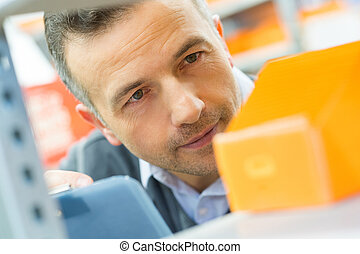 worker looking at something in a warehouse