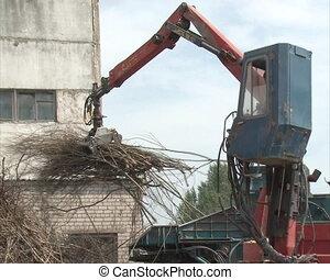 worker machine crush wood - special equipment with crane...