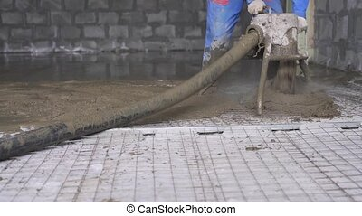 Worker making cement screed on the floor view - Worker...