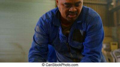 Worker making mold in foundry workshop. Worker shaping mold 4k