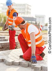 Worker making new pavement