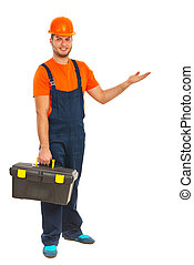 Full length of worker man making presentation isolated on white background