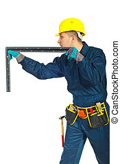Mid adult worker man measure with a L square ruler and standing in profile isolated on white background