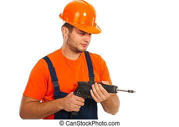 Worker man with a drill