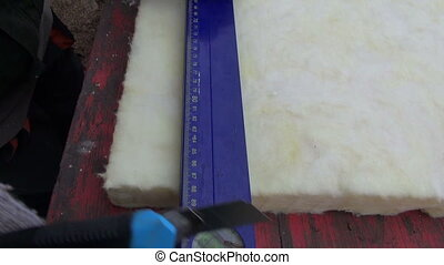 cut house insulation material - worker measure and cut house...