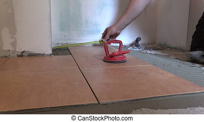 worker measure tile