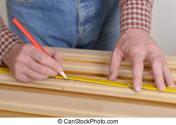 Worker measures the plank