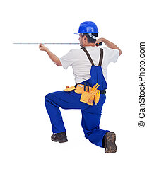 Worker measuring with tape