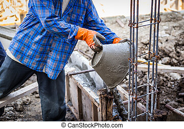 worker mixing cement mortar plaster for construction