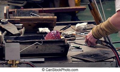 Worker modeling handmade decorative glass object - Handmade ...