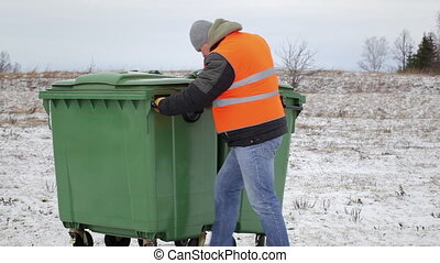 Worker near the garbage containers