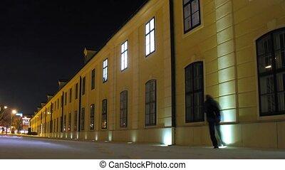 Worker of lock switch on illumination of Shonbrunn palace,...