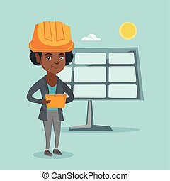 Worker of solar power plant using digital tablet . - African...