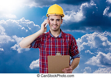 worker of the construction with the phone mobile