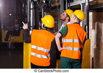 Worker on forklift in warehouse