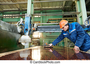 worker on granite manufacture - industrial worker at factory...