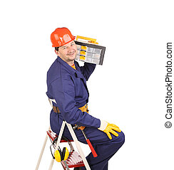 Worker on ladder holding toolbox.