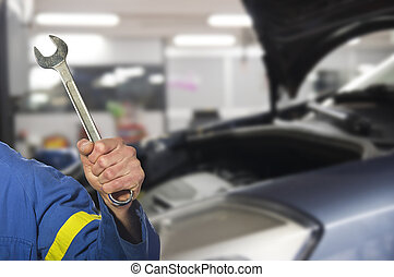 worker on the shop floor while repairing a car