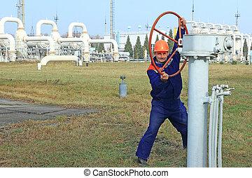 Worker opening big valve