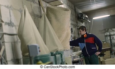 Worker operating air conditioning equipment - Young...