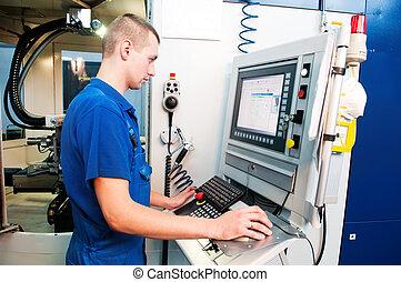 worker operating CNC machine center - mechanical technician...