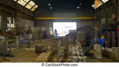 Worker operating crane in foundry workshop 4k - Worker ...