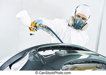 worker painting auto car bumper - automobile repairman...