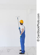 Worker painting wall