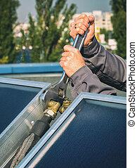 Worker performs the installation of solar panels