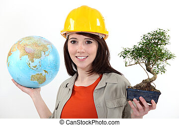 Worker planting trees abroad