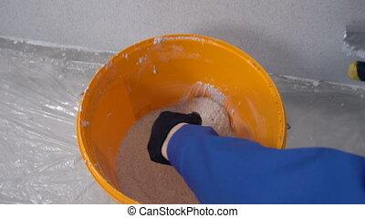 Worker Plasterer Wall - The worker plasterer plaster wall...