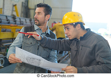 worker pointing at the right employee