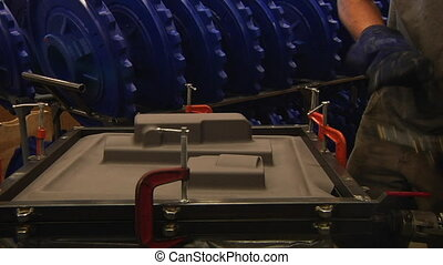 worker prepares injection molding