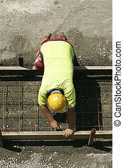 Worker preparing formwork