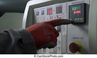 Worker presses button on control panel - Furniture...