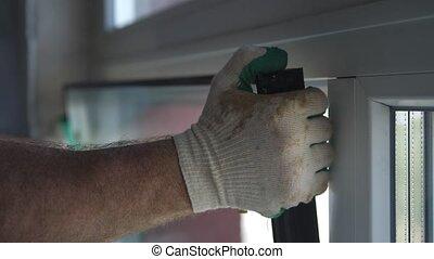 Worker put window sash into new installed frame.