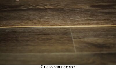 Worker puts the board flooring. laying laminate flooring
