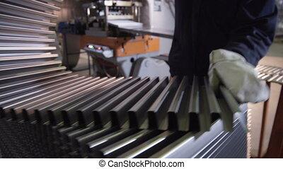 Worker putting Bending aluminium sheet at metallurgical...