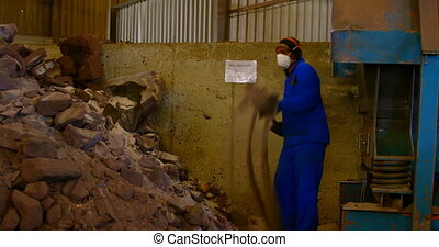 Worker putting soil in machine at foundry workshop 4k - ...