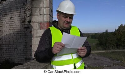 Worker reading, tear and throw documents