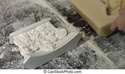 Worker removing silicone mold from gypsum piece. Beautiful...