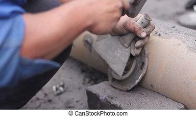 Worker repairing the item of conveyor