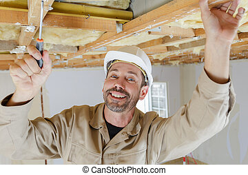 worker repairing the wood ceiling