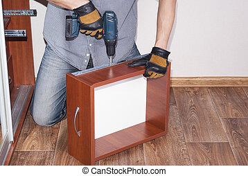 worker repairs furniture