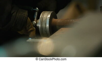 Worker rotate the handle of lathe