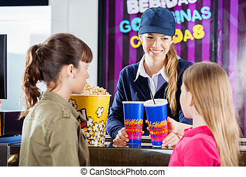 Worker Selling Snacks To Girls At Concession Counter