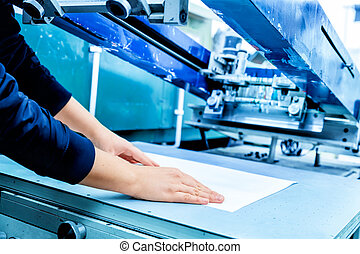 Worker setting print screening metal machine