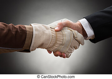 Worker Shaking Hand With Businessman - Close-up Of Worker...