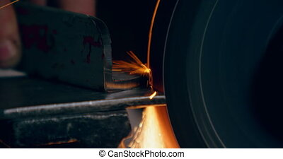 Close-up of worker shaping metal on machine in aircraft hangar 4k